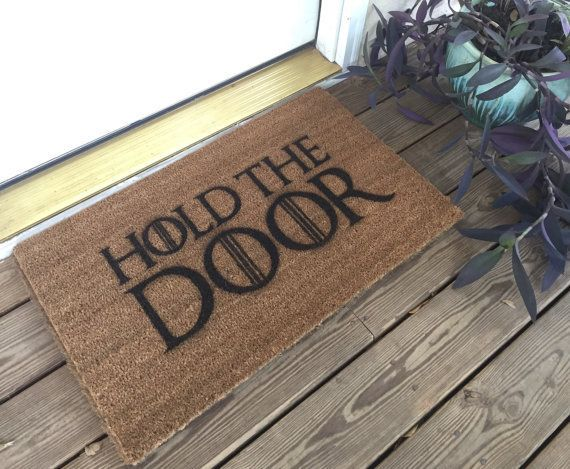 "Hold the door mat, <a href=""https://www.etsy.com/listing/466576666/game-of-thrones-hold-the-door-mat"" target=""_blank"">$34.99"