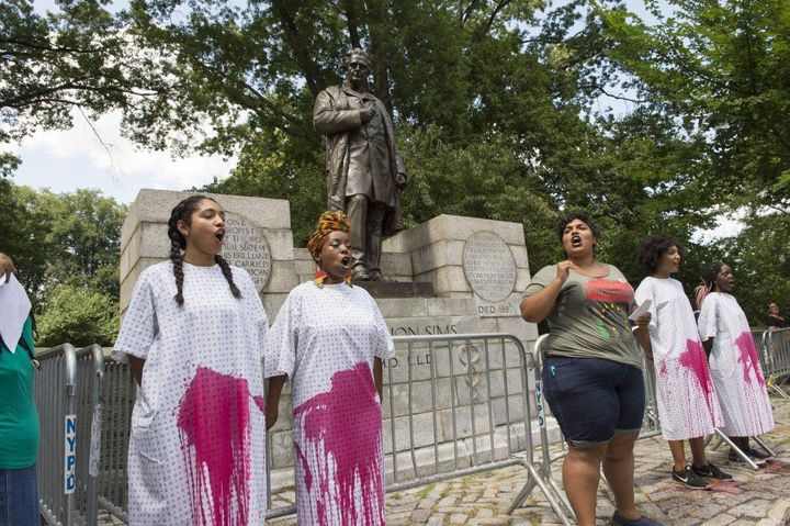Protesters demand that the New York City Parks Department remove the statue of Dr. J. Marion Sims from its current location o