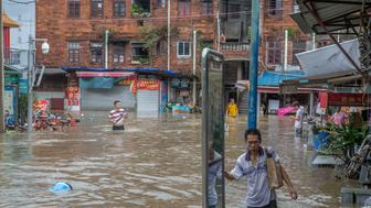 GUANGZHOU, CHINA - AUGUST 23: A man walks in the flooding caused by Typhoon Hato and the astronomical tide on August 23, 2017 in Guangzhou, China.  It is the most powerful typhoon to strike China this year.  PHOTOGRAPH BY Feature China / Barcroft Images  London-T:+44 207 033 1031 E:hello@barcroftmedia.com - New York-T:+1 212 796 2458 E:hello@barcroftusa.com - New Delhi-T:+91 11 4053 2429 E:hello@barcroftindia.com www.barcroftimages.com (Photo credit should read Feature China / Barcroft Images / Barcroft Media via Getty Images)