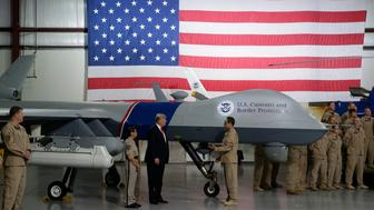 U.S. President Donald Trump views a drone aircraft used to patrol the border at U.S. Customs and Border Patrol facility in Yuma, Arizona, U.S., August 22, 2017. Picture taken August 22, 2017.   REUTERS/Joshua Roberts