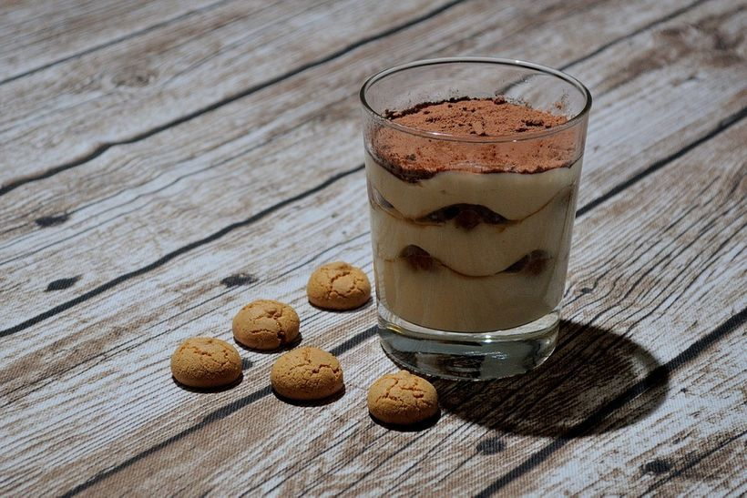 Tiramisù is made with coffee-soaked ladyfinger biscuits layered between whipped cream made of egg yolks, mascarpone cheese an