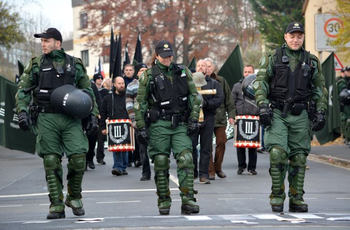German police escort a neo-Nazi rally through the streets of Wunsiedel, Germany.