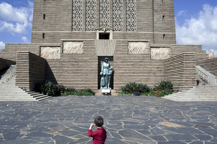 A boy stands at the Voortrekker Monument. Pretoria, South Africa. April 29.