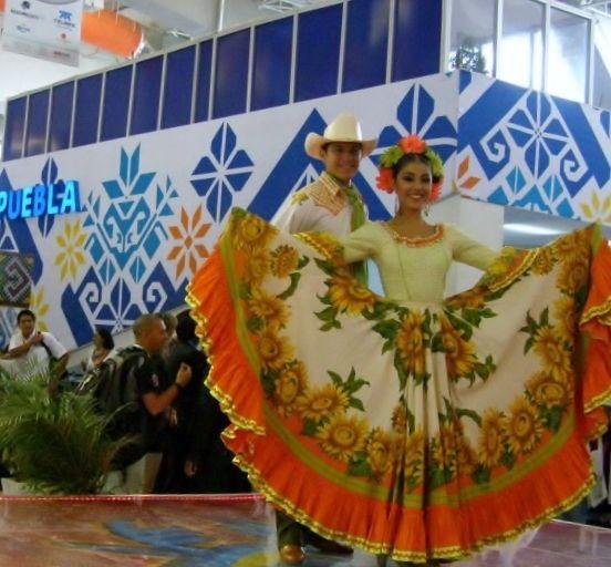 """Model shows off """"China"""" dress at Mexico's <em>Tianguis</em> travel trade fair."""