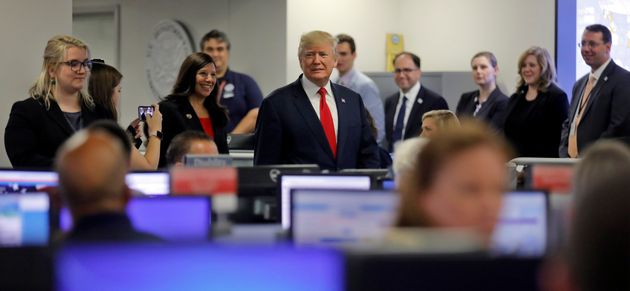 President Donald Trump toursFederal Emergency Management Agency headquarters after an Aug. 4 briefing...