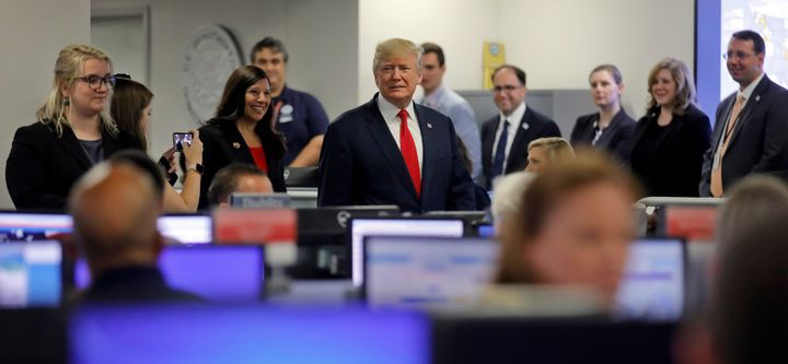 President Donald Trump tours Federal Emergency Management Agency headquarters after an Aug. 4 briefing on hurricane seas