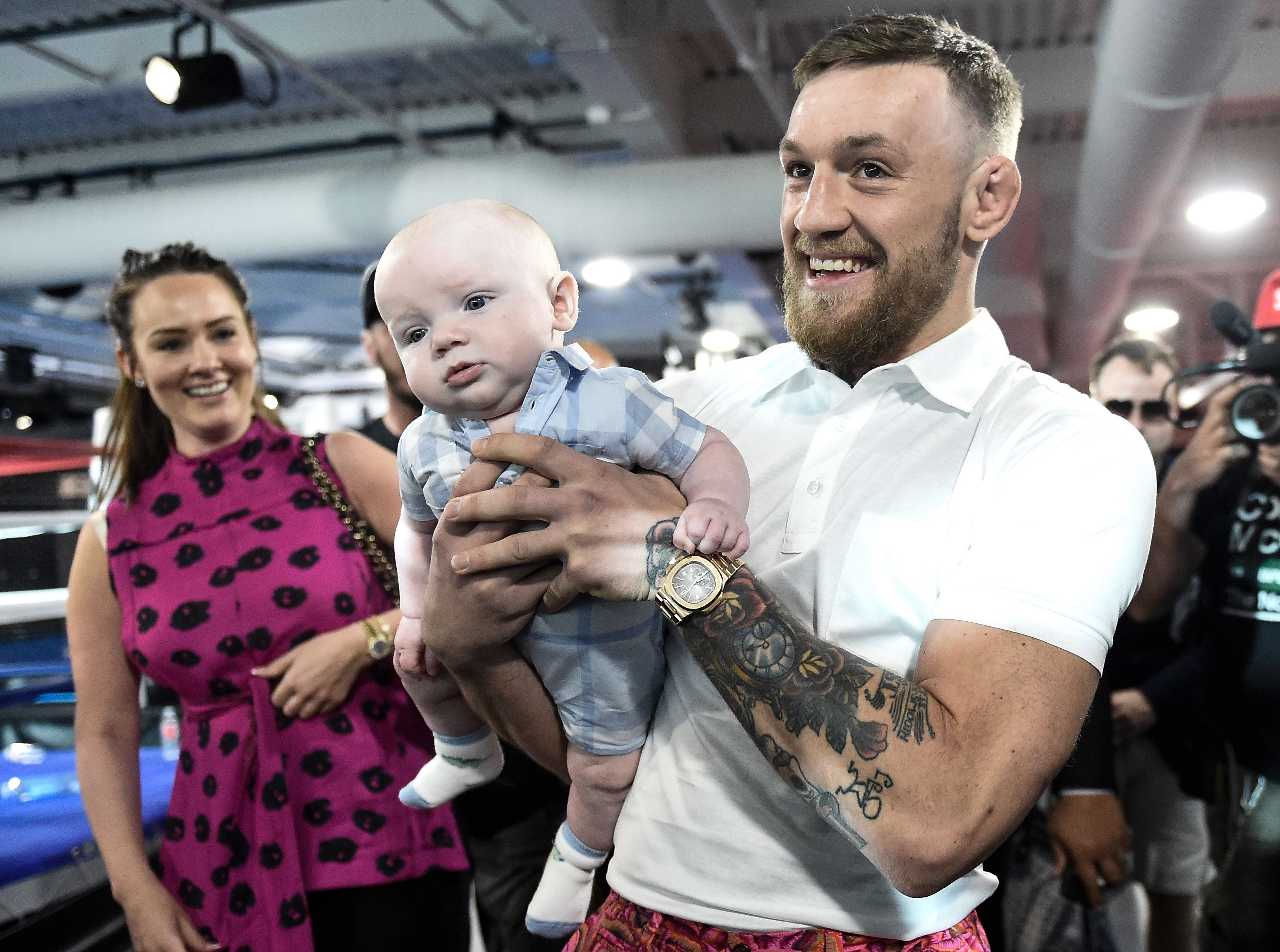 LAS VEGAS, NV - AUGUST 11:  UFC lightweight champion Conor McGregor carries his son Conor McGregor Junior during a media workout at the UFC Performance Institute on August 11, 2017 in Las Vegas, Nevada. McGregor will fight Floyd Mayweather Jr. in a boxing match at T-Mobile Arena on August 26 in Las Vegas. (Photo by Brandon Magnus/Zuffa LLC/Zuffa LLC via Getty Images)