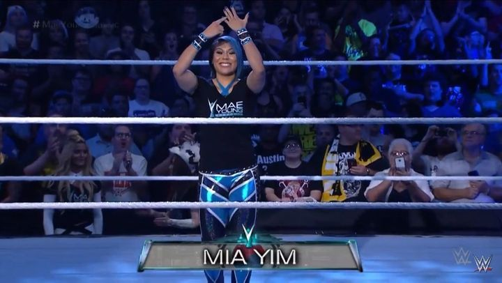 Mia Yim points to her purple nail during her in-ring entrance during WWE's Mae Young Classic.