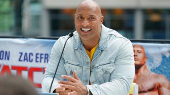 BERLIN, GERMANY - MAY 30:  Dwayne Johnson is seen on stage at the 'Baywatch' Photo Call at Sony Centre on May 30, 2017 in Berlin, Germany.  (Photo by Andreas Rentz/Getty Images for Paramount Pictures)