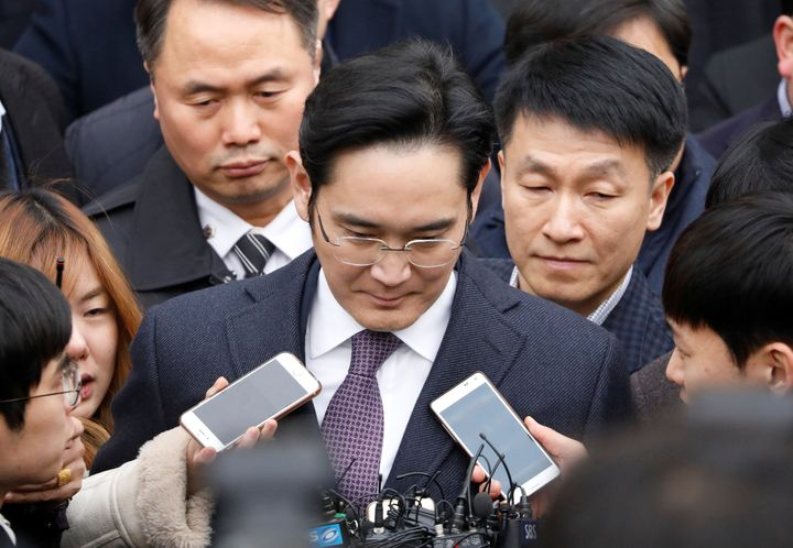 Samsung Group chief, Jay Y. Lee, was sentenced to five years behind bars on Friday for his participation in a corruption scan