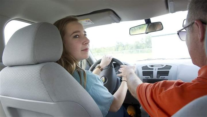 Olivia Glover looks over her shoulder as she gets a lesson in parallel parking from a driving instructor in Grovetown, Georgi
