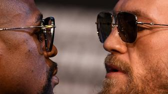 Nevada , United States - 23 August 2017; Conor McGregor and Floyd Mayweather Jr square off during a news conference at the MGM Grand in Las Vegas, USA, ahead of their super welterweight boxing match at T-Mobile Arena in Las Vegas on Saturday August 26. (Photo By Stephen McCarthy/Sportsfile via Getty Images)