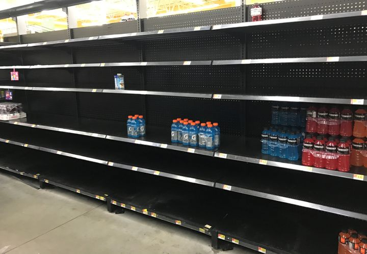 Store shelves in a Houston-area Walmart sit empty Friday, ahead of Hurricane Harvey.