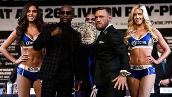 LAS VEGAS, NV - AUGUST 23:  (L-R) Boxer Floyd Mayweather Jr. and UFC lightweight champion Conor McGregor pose during a news conference at the KA Theatre at MGM Grand Hotel & Casino on August 23, 2017 in Las Vegas, Nevada. The two will meet in a super welterweight boxing match at T-Mobile Arena on August 26 in Las Vegas.  (Photo by Brandon Magnus/Zuffa LLC/Zuffa LLC via Getty Images)