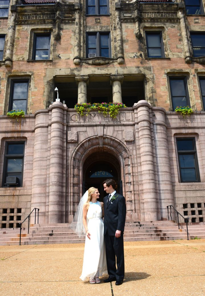 The couple standing outside St. Louis City Hall on their wedding day.