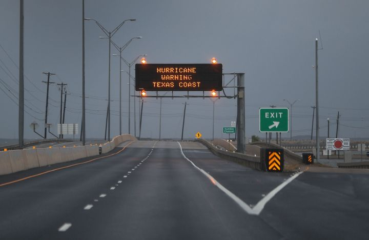 A road sign warns travelers of Hurricane Harvey on Friday in Corpus Christi, Texas.