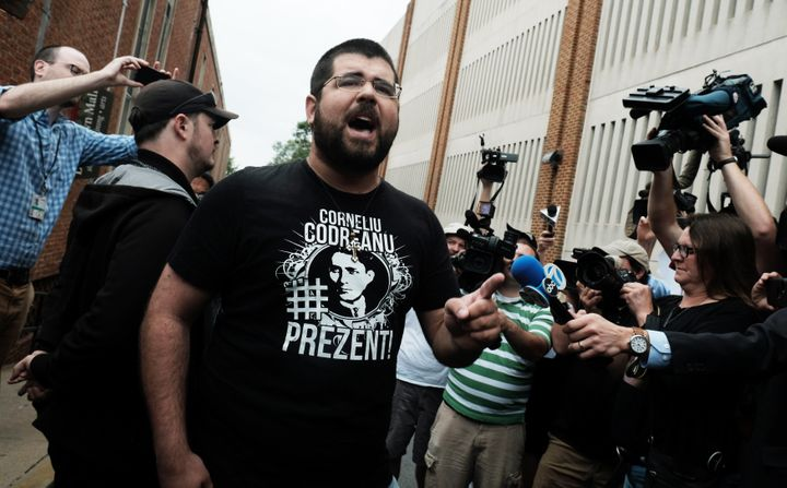 White nationalist leader Matthew Heimbach yells at the media outside the Charlottesville General Courthouse on Aug. 14, photo by Justin Ide/Reuters