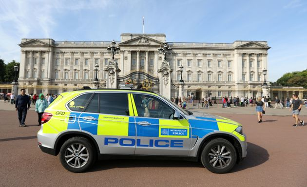 A police vehicle patrols outside Buckingham Palace on