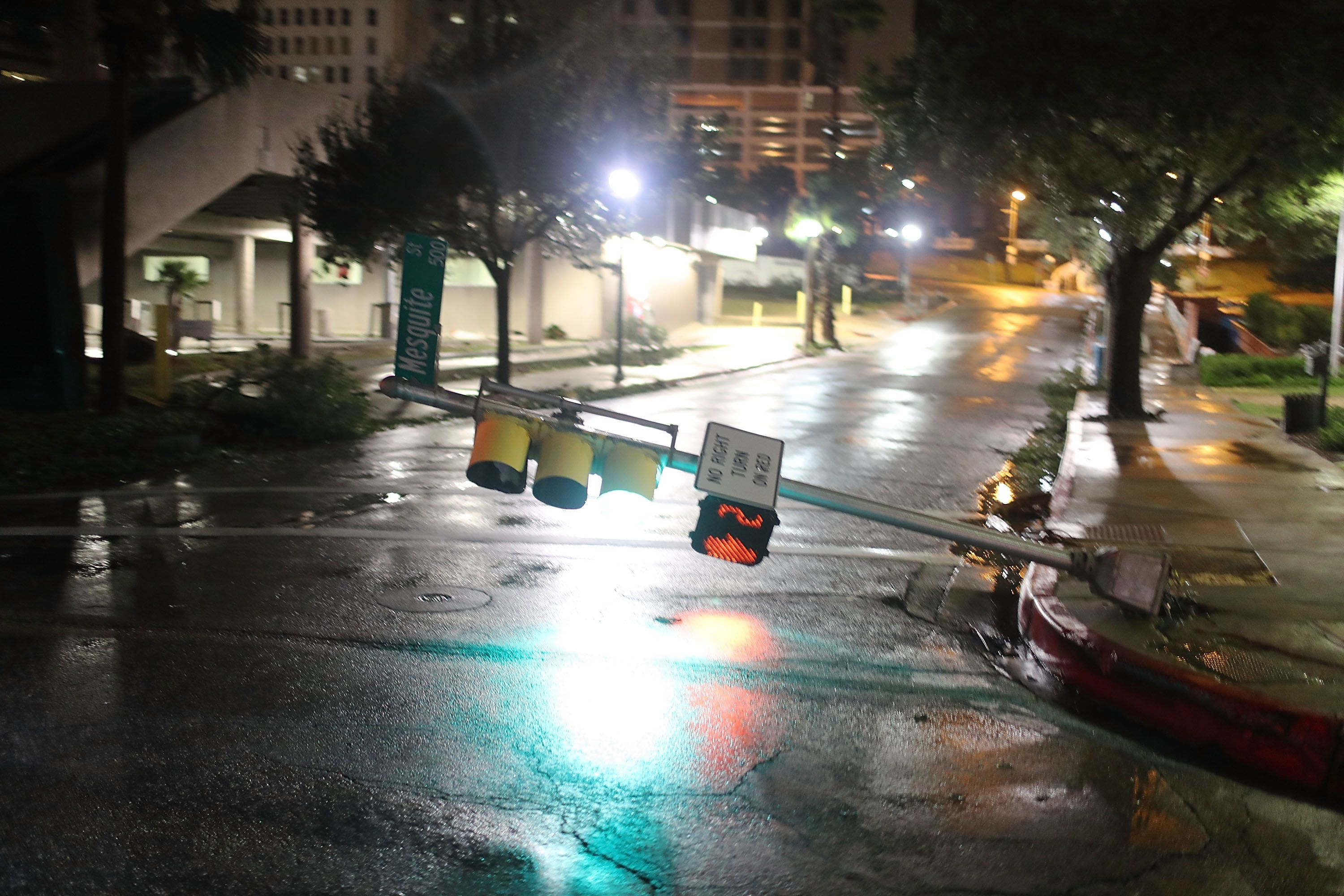A street light is knocked off its base by the winds in Corpus Christi.