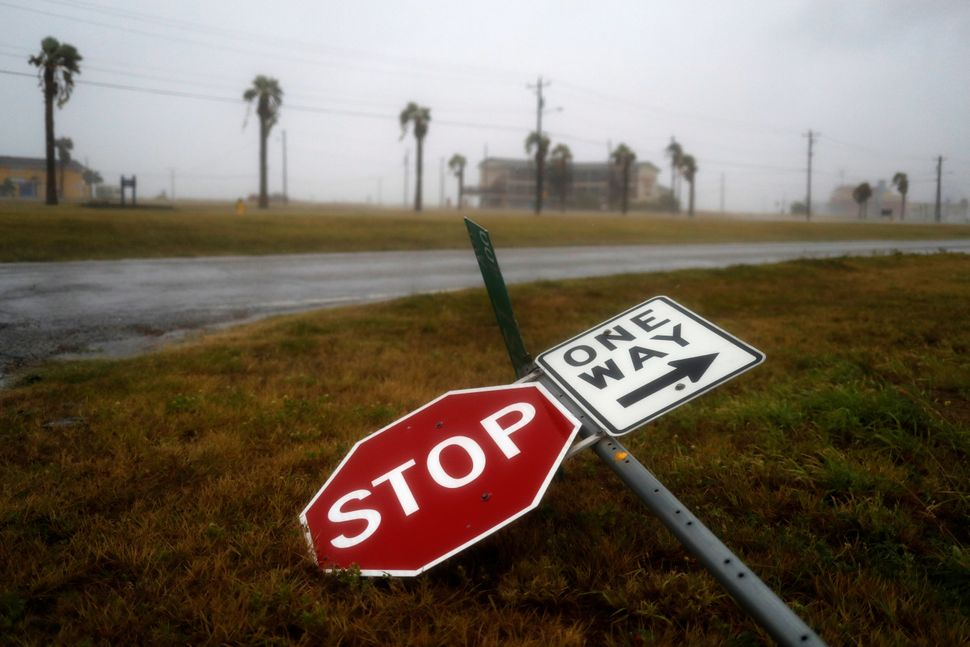 Street signs lie on the ground after winds from Hurricane Harvey escalated in Corpus Christi on Aug. 25, 2017.