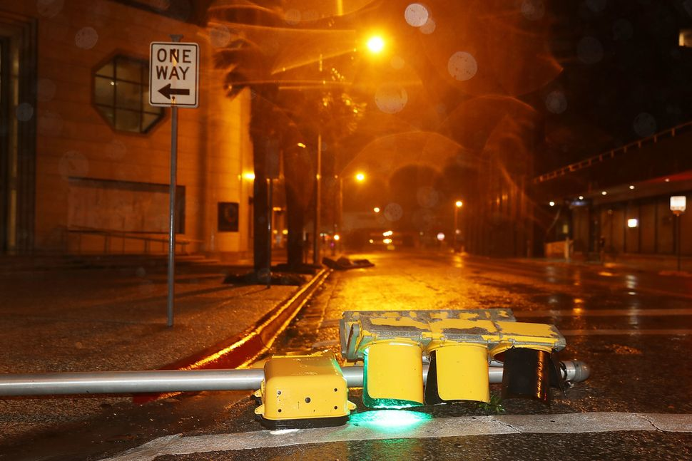 A street light lies in the street after being blown over in Corpus Christi.