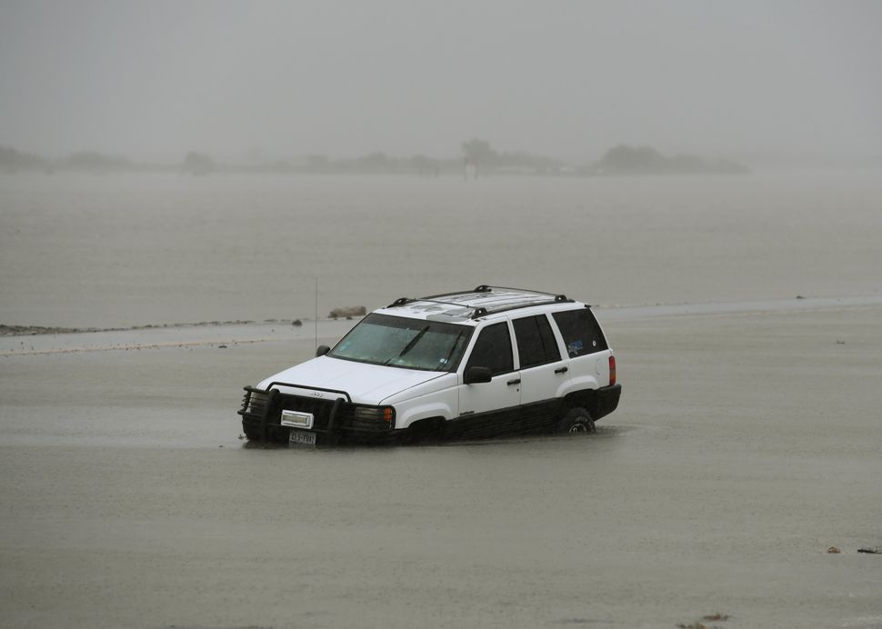 A car lies submerged in Corpus Christi.
