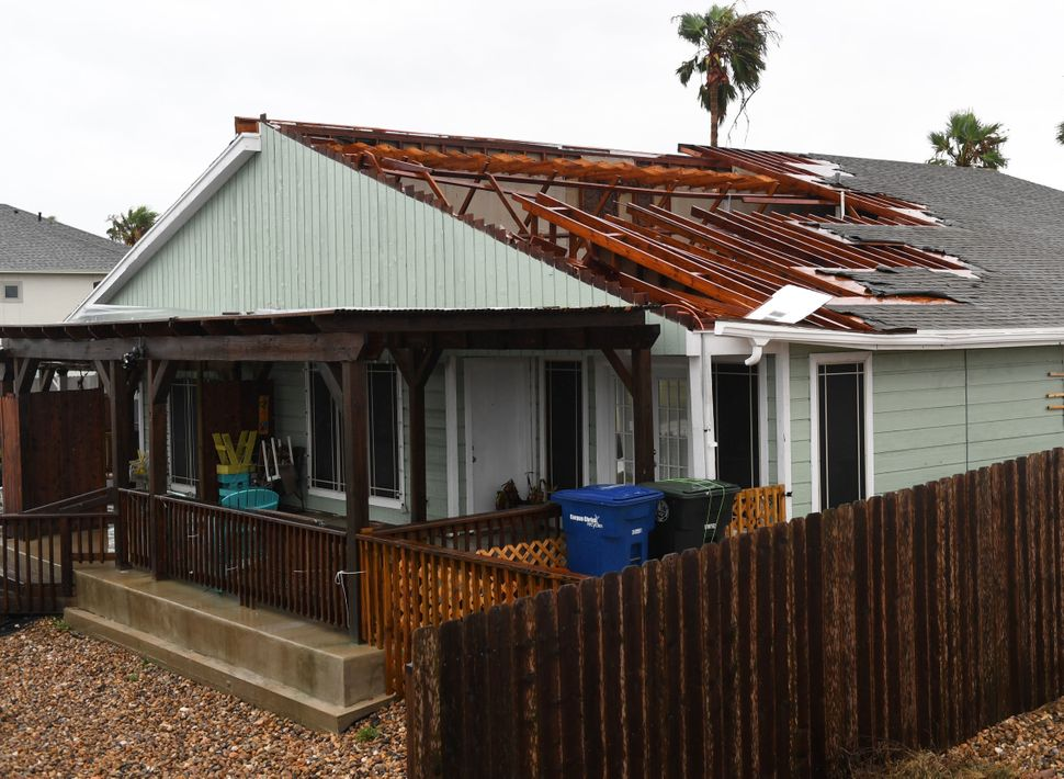 A house suffers roof damage in Corpus Christi.
