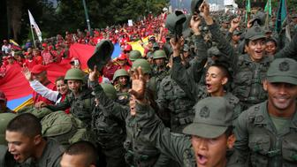 Civilians and members of the National Bolivarian Armed Forces parade during a military exercise in Caracas, Venezuela, August 26, 2017. REUTERS/Andres Martinez Casares