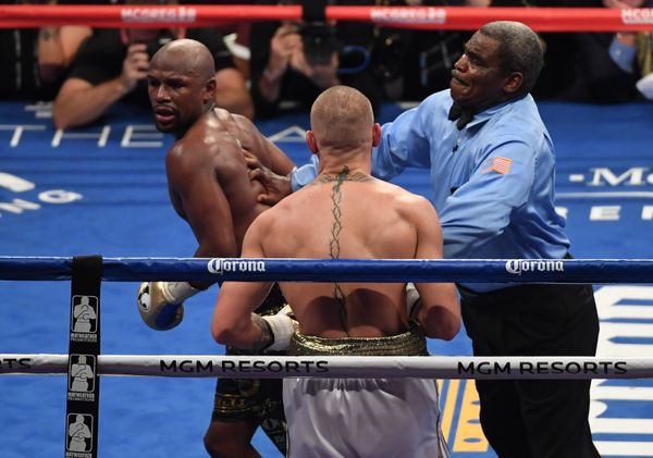 LAS VEGAS, NV - AUGUST 26:  Referee Robert Byrd stops the fight in round 10 with a TKO of Conor McGregor by Floyd Mayweather