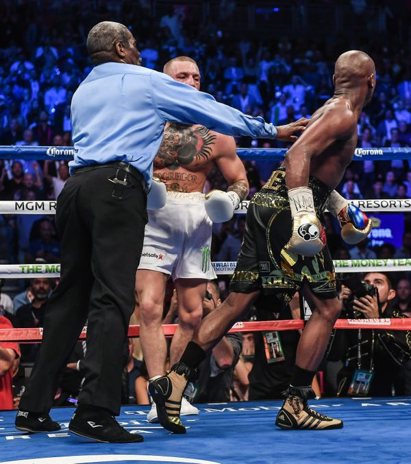 Nevada , United States - 26 August 2017; Referee Robert Byrd separates Floyd Mayweather Jr, right, from Conor McGregor after