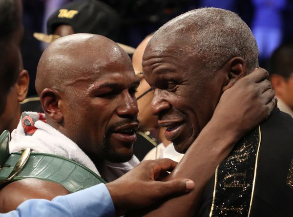 LAS VEGAS, NV - AUGUST 26:  (L-R) Floyd Mayweather Jr. hugs Floyd Mayweather Sr. after defeating Conor McGregor by TKO in the