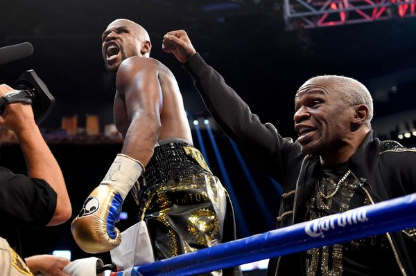 LAS VEGAS, NV - AUGUST 26:  (L-R) Floyd Mayweather Jr. and  Floyd Mayweather Sr. celebrate after defeating Conor McGregor dur