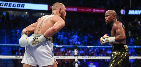 Nevada , United States - 26 August 2017; Conor McGregor, left, and Floyd Mayweather Jr during their super welterweight boxing