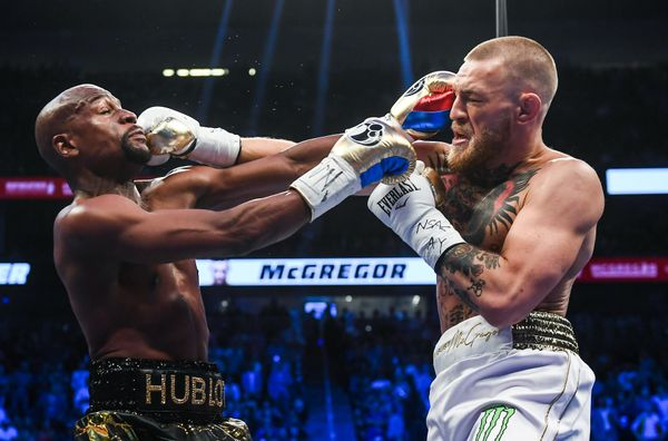 Nevada , United States - 26 August 2017; Conor McGregor, right, and Floyd Mayweather Jr during their super welterweight boxin