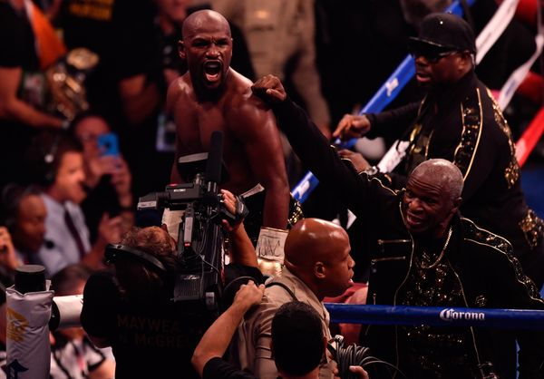 LAS VEGAS, NV - AUGUST 26:  (L-R) Floyd Mayweather Jr. and  Floyd Mayweather Sr. celebrate after defeating Conor McGregor by