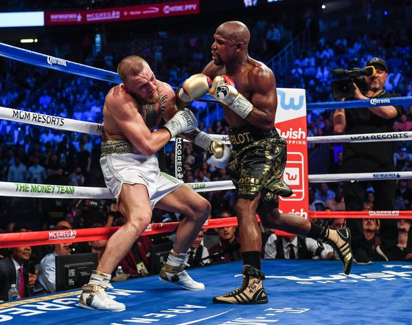 Nevada , United States - 26 August 2017; Floyd Mayweather Jr, right, and Conor McGregor during their super welterweight boxin
