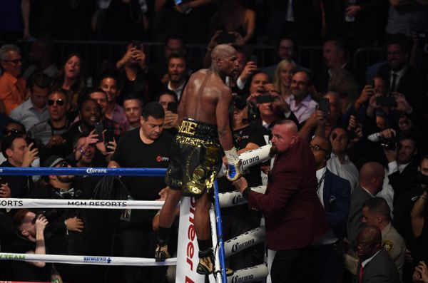 LAS VEGAS, NV - AUGUST 26:  Floyd Mayweather Jr. celebrates his TKO of Conor McGregor in their super welterweight boxing matc