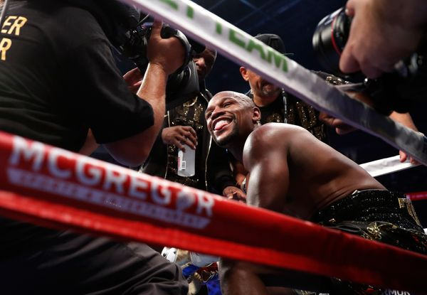 Boxing - Floyd Mayweather Jr. vs Conor McGregor - Las Vegas, USA - August 26, 2017  Floyd Mayweather Jr. smiles as he sits in