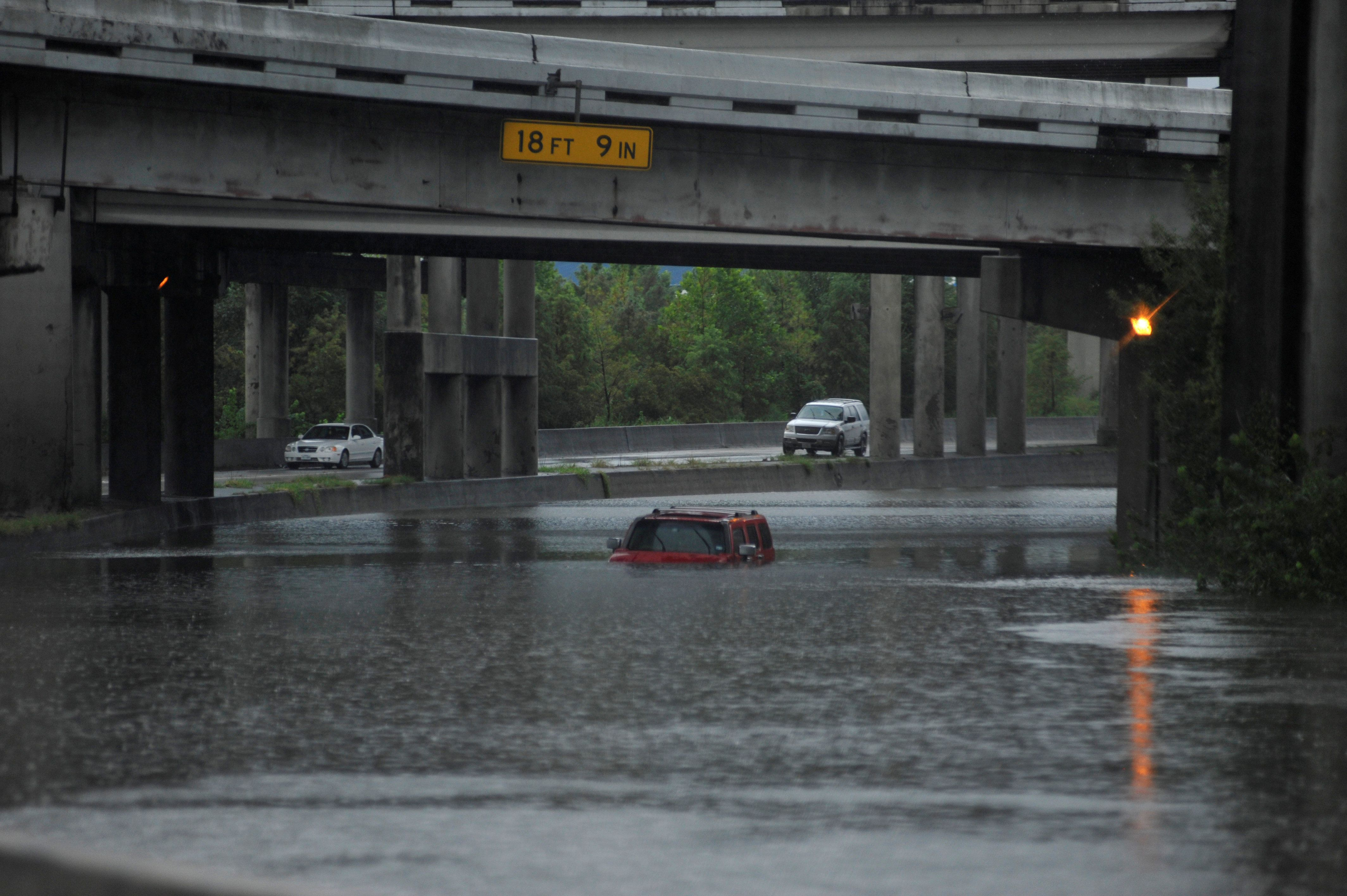 An abandoned Hummer is covered in floodwatersalong Interstate 610 in Houston on