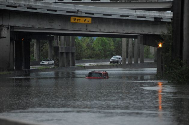 An abandoned Hummer is covered in floodwaters along Interstate 610 in Houston on