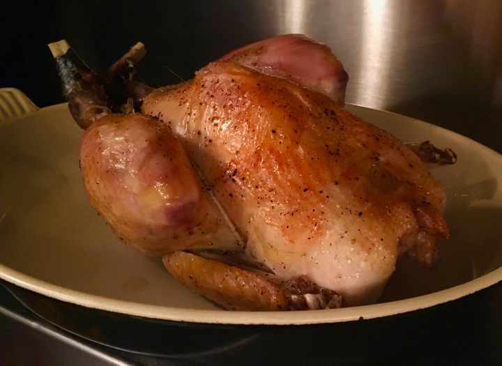 Pot-roasted chicken resting while the sauce is adjusted and strained