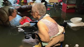 Residents of a flooded assisted living home in southeast Texas are seen before their rescue on Sunday