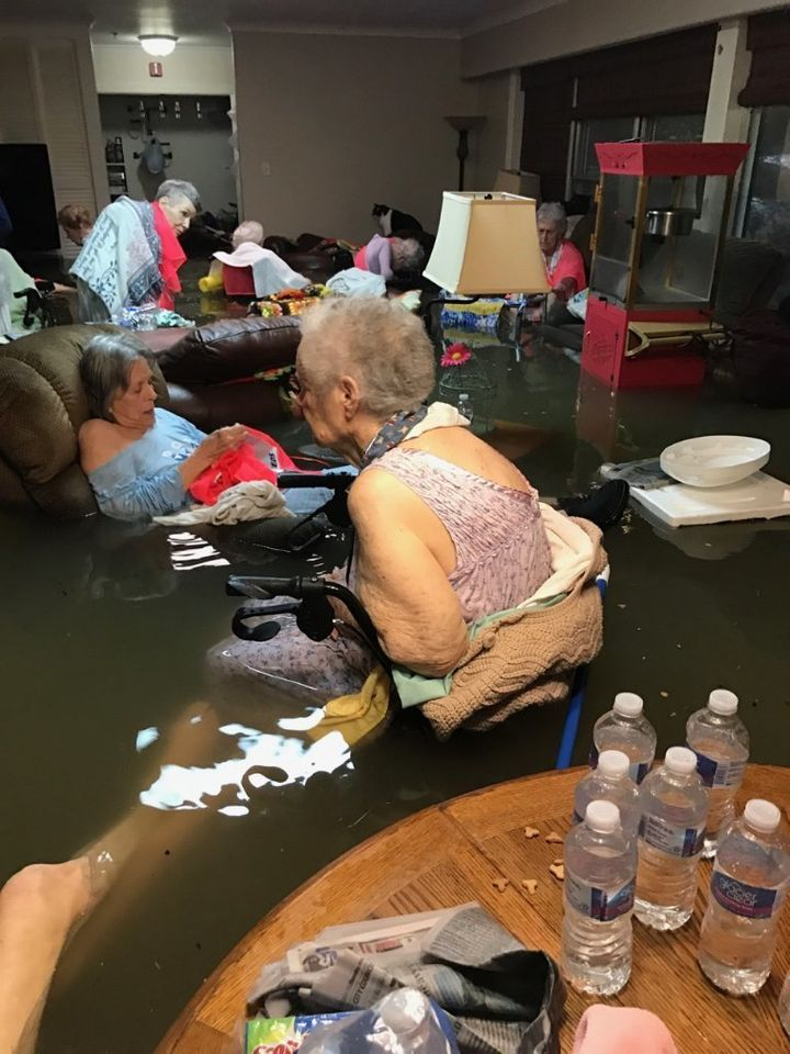 Residents of a flooded assisted living home in southeast Texas before their rescue on Sunday.