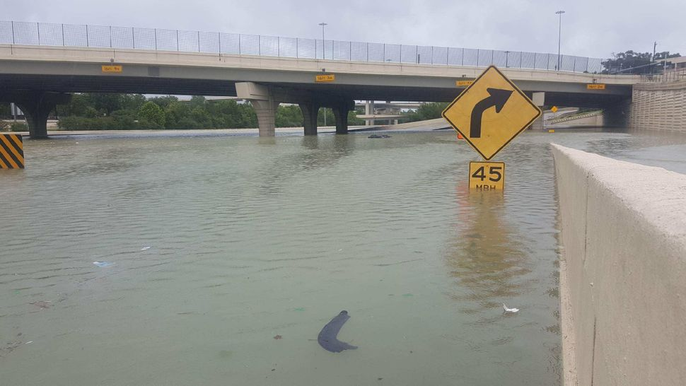 A partially submerged highway sign in Houston.
