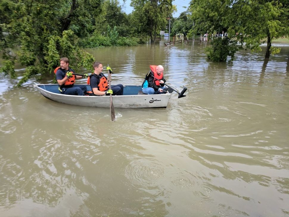 People in a boatfollowing this weekend's heavy rain.