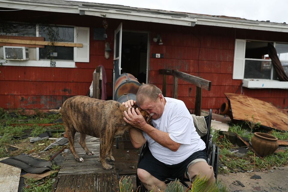 Steve Culver cries with his dog Otis as he talks about what he said was the, 'most terrifying event in his life,' when Hurric
