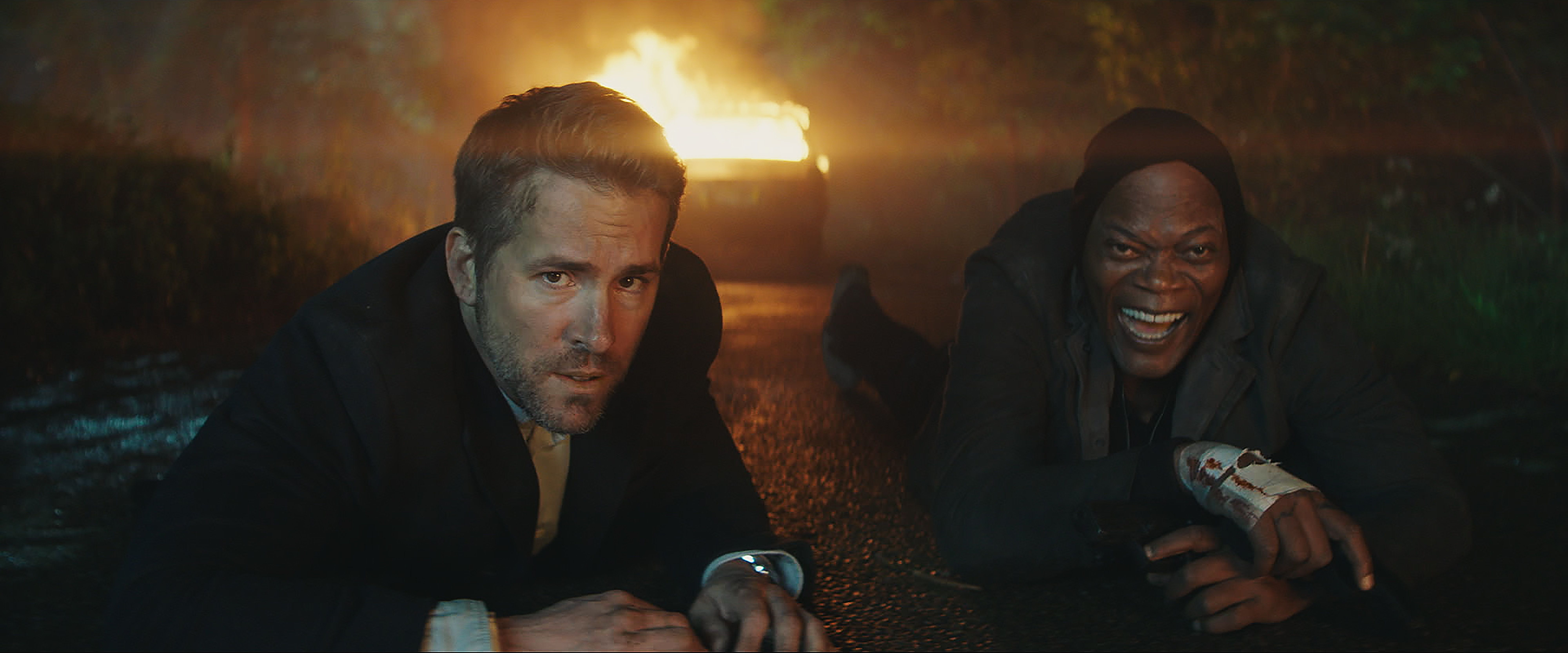 Michael Bryce (Ryan Reynolds) and Darius Kincaid (Samuel L. Jackson) in THE HITMAN'S BODYGUARD. Image Courtesy of Lionsgate Entertainment.
