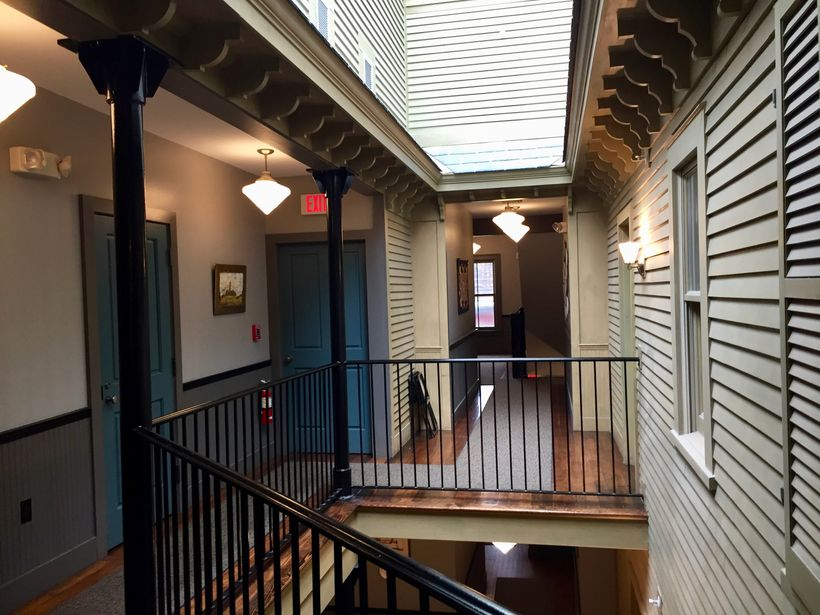 The interior hallways of Porches Inn at Mass MOCA are whimsically designed to look like an exterior.