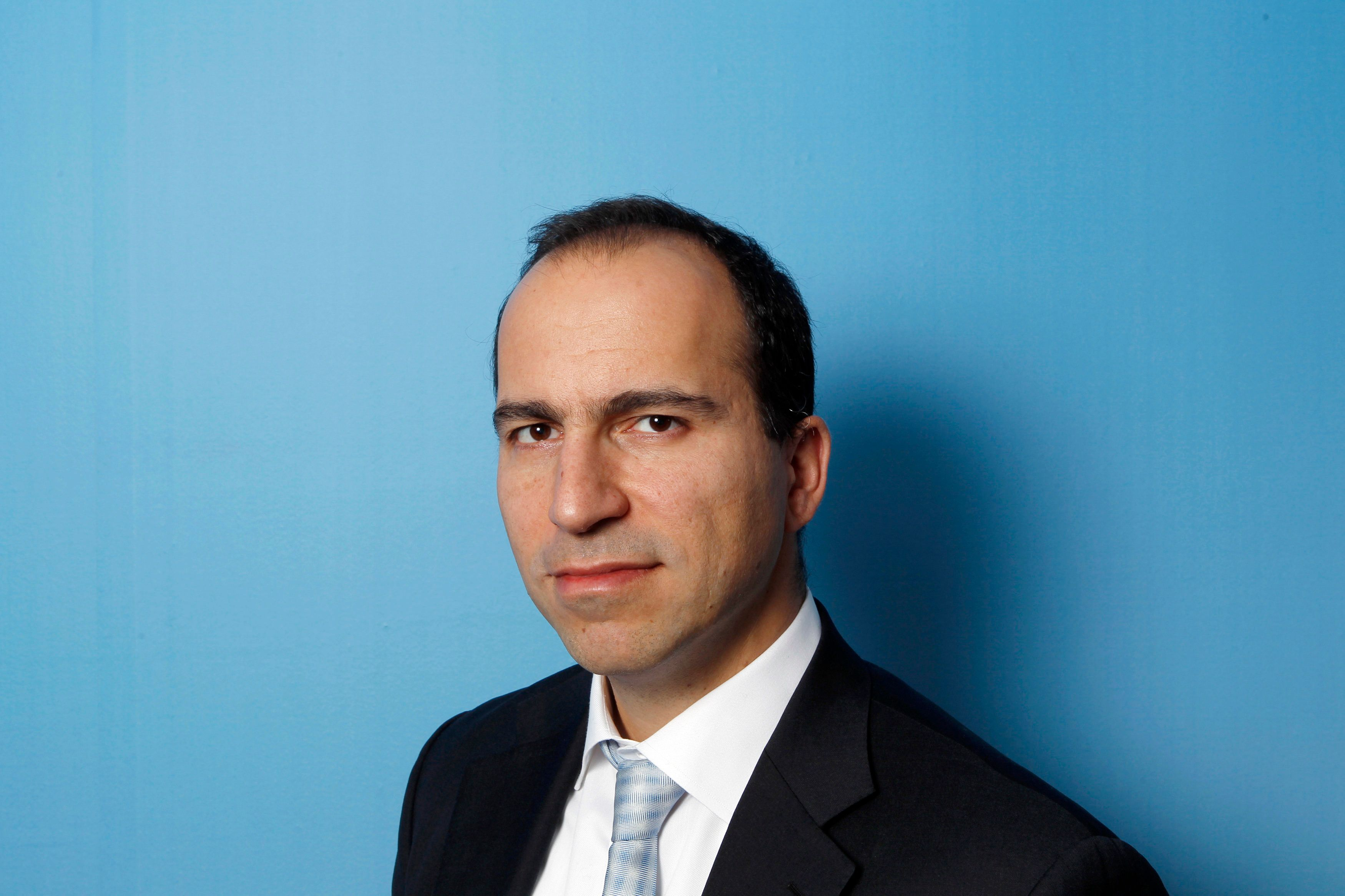 Expedia CEO Dara Khosrowshahi poses for a portrait during the 2010 Reuters Travel and Leisure Summit in New York February 22, 2010.  REUTERS/Lucas Jackson (UNITED STATES - Tags: BUSINESS TRAVEL)