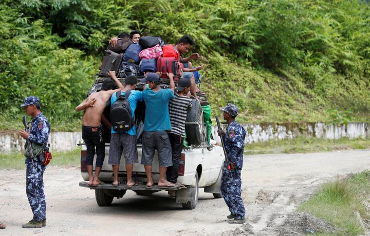 Ethnic Rakhine people who fled from Maungdaw after Arakan Rohingya Salvation Army (ARSA) had attacked, arrive in Buthidaung,